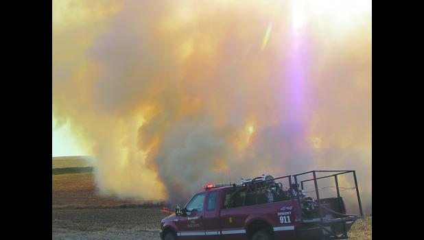 Denison and Dow City fire departments were called to field fire and combine fire on Oct. 15. Photo by Jim Clark.