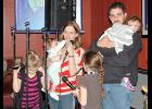 Adam and Sadie (Clark) McGruder offer their thanks at Saturday's fundraiser in Gayville for those who have supported their family after they lost their home and possessions in a Jan. 14 house fire. The McGruders are joined on stage by daughters Fayth, 8; Cassidy, 7; Autumn, 5; Grace 1 1/2 and Evalyn, 7 months.