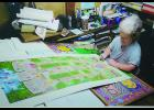 Carolyn Blattel-Britton is shown working on the Iowa Firefighters Memorial drawing she completed in 2012. Blattel-Britton recently died unexpectedly at the age of 64.